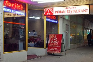Don't head to Surjit's for the location. Go there for the food.